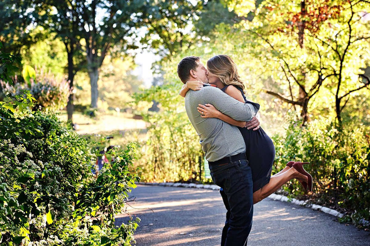 Engaged Couple kissing in a park in Mckinney TX