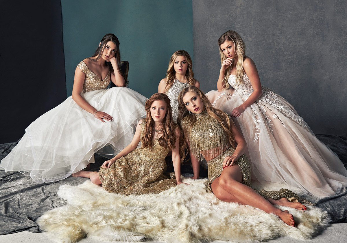 dallas prom group photos in studio on a white rug with sherri hill gowns