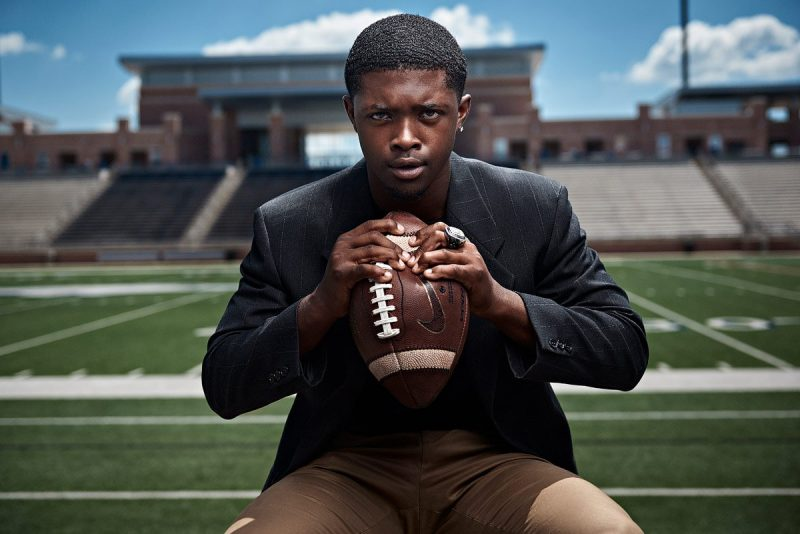 Allen senior portraits eagles football captain mo perkins in stands crushing football