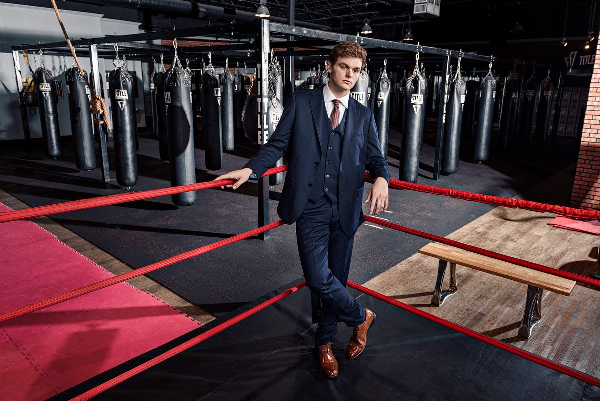 plano senior photos in boxing gym wearing blue suit from ISW plano tx
