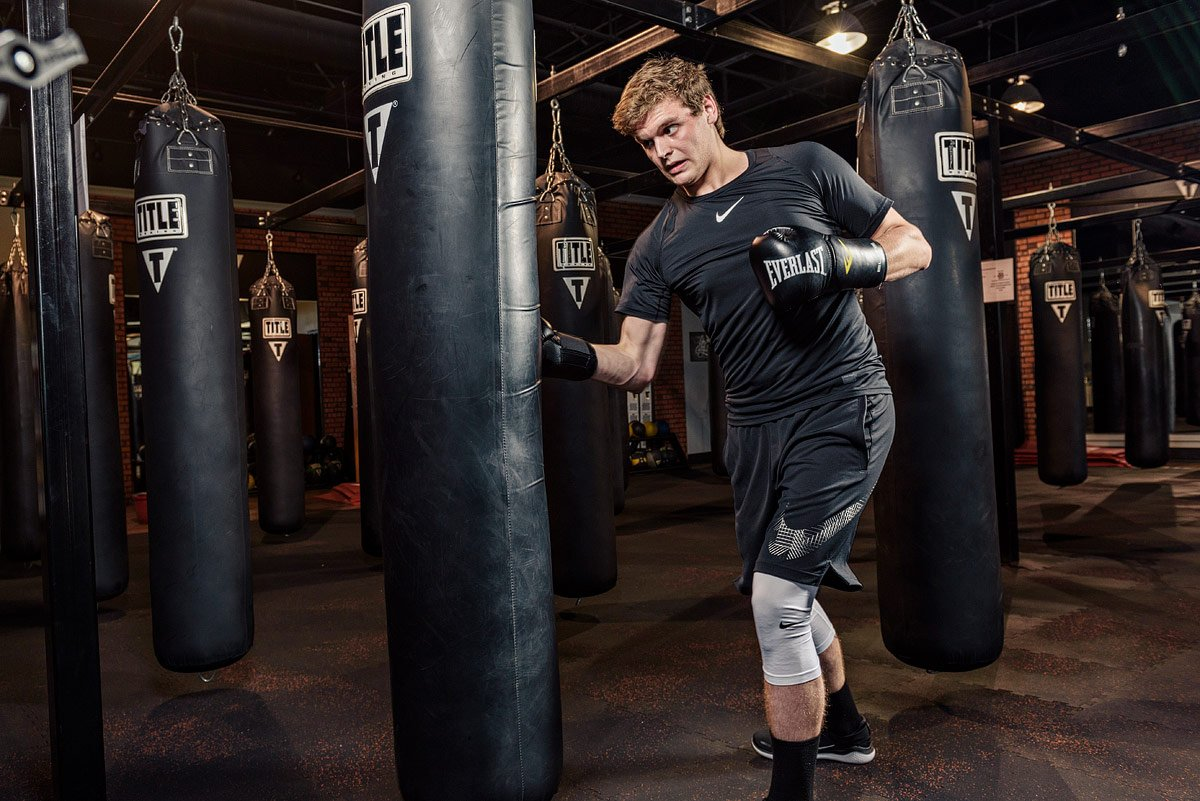Dallas Senior Photographer gym punching bag action photos