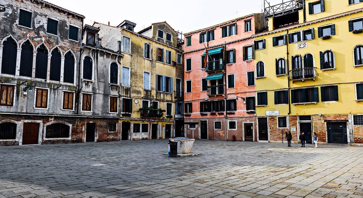 piazza with colorful houses by travel photographer