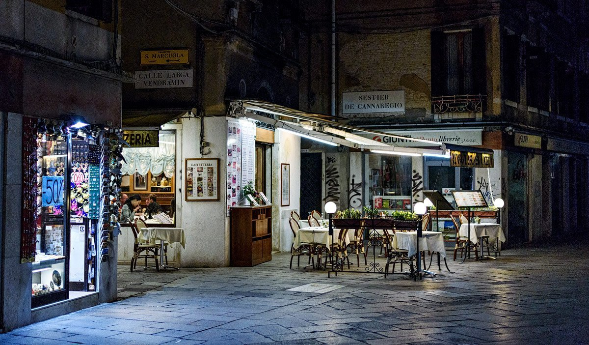 empty table at night in venice italy at restaurant
