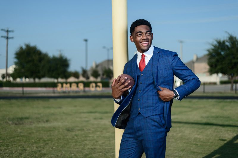 senior pictures in mckinney texas by jeff dietz photography of McKinney north football player in suit