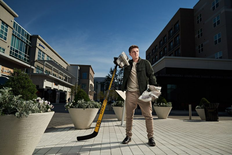 Mckinney Boyd Senior Portraits Hockey player in streets of legacy west