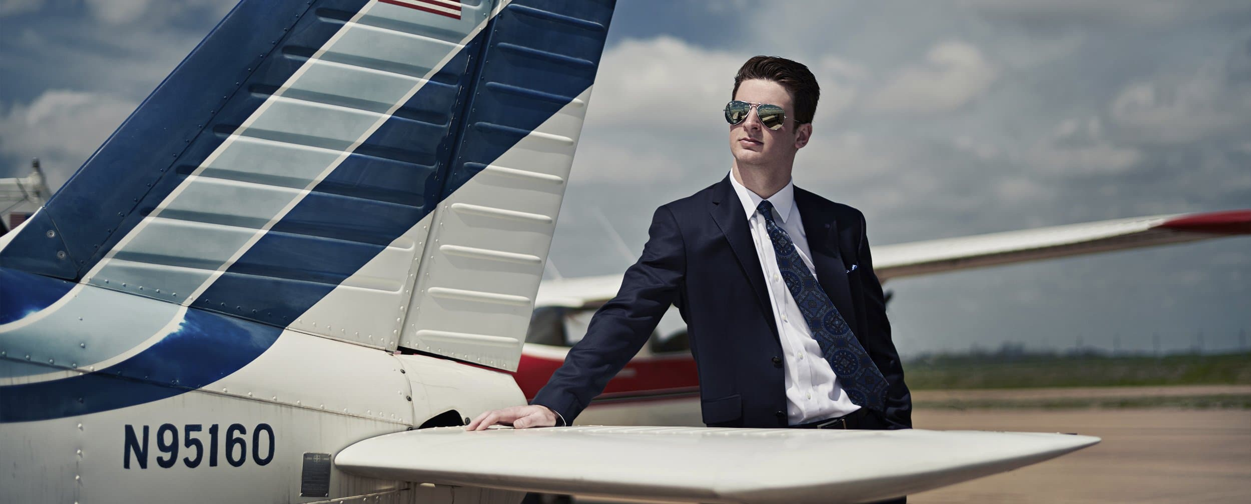 Dallas Senior Portraits Photographer Banner Photo boy in suit and airplane