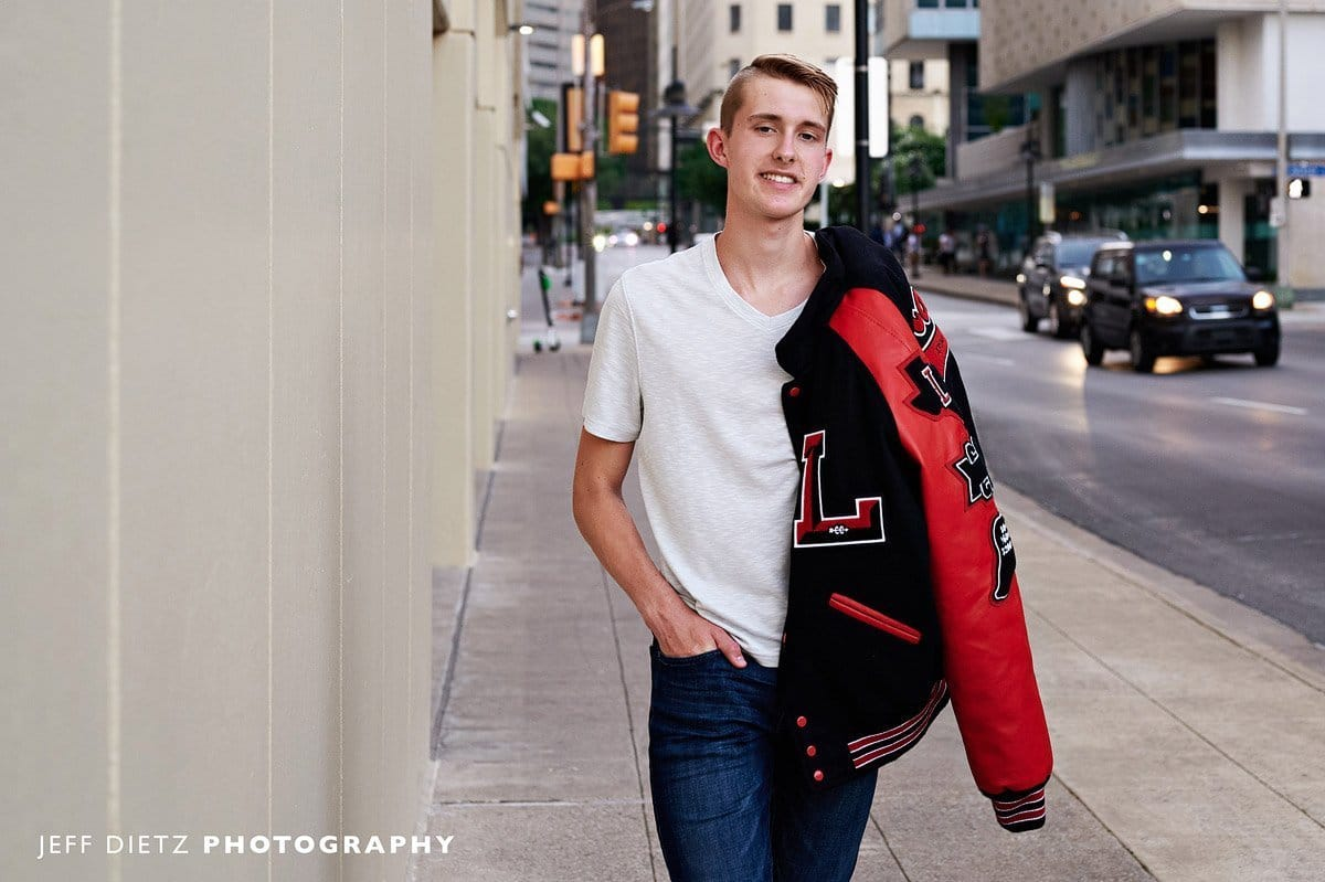 frisco liberty senior pictures in letterman jacket track and field walking