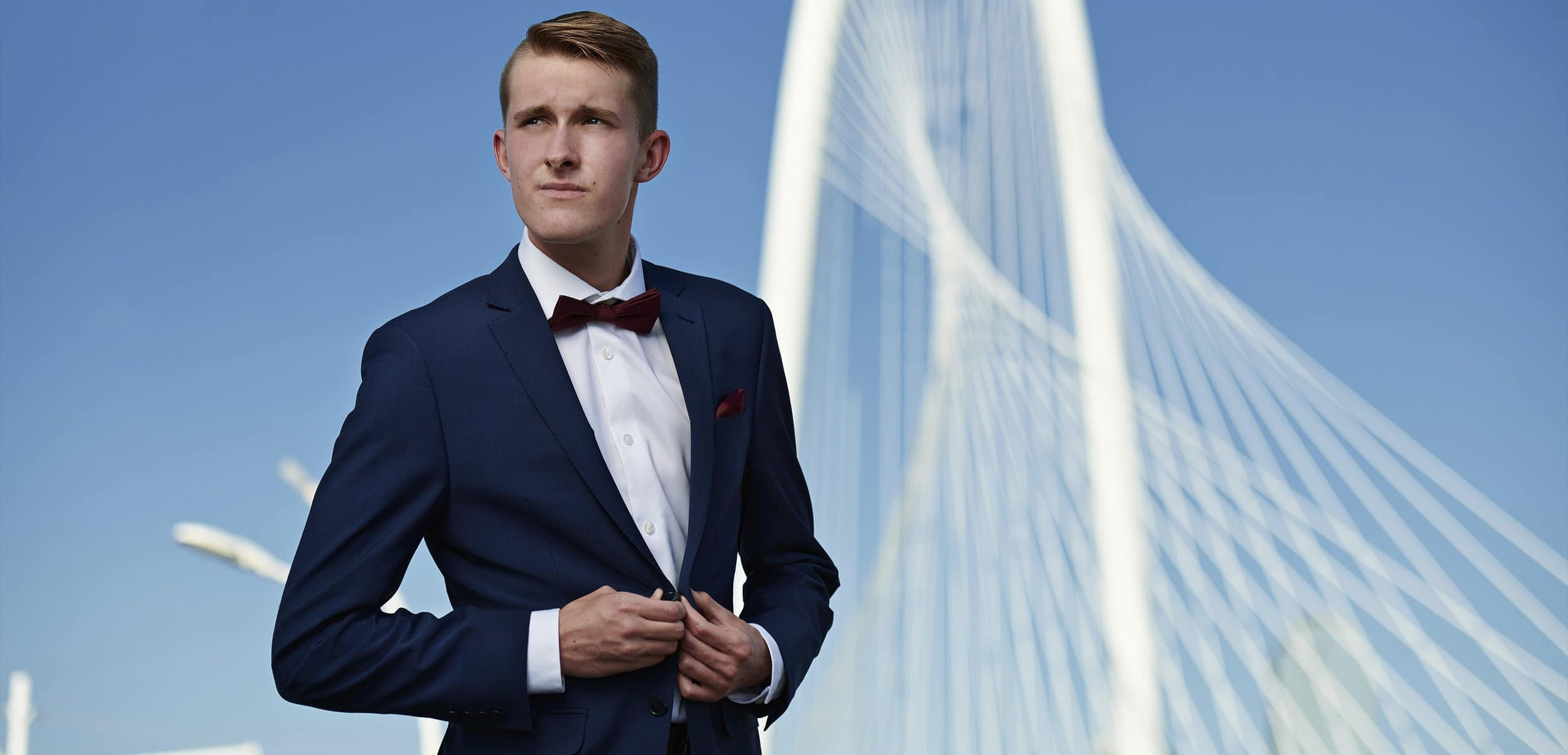 frisco liberty senior pictures in dallas blue suit hunt hill bridge banner
