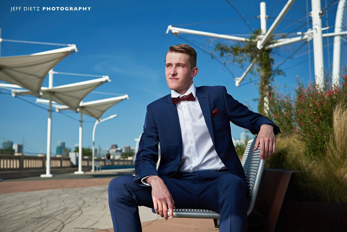 frisco liberty senior portraits of track in suit on dallas bridge