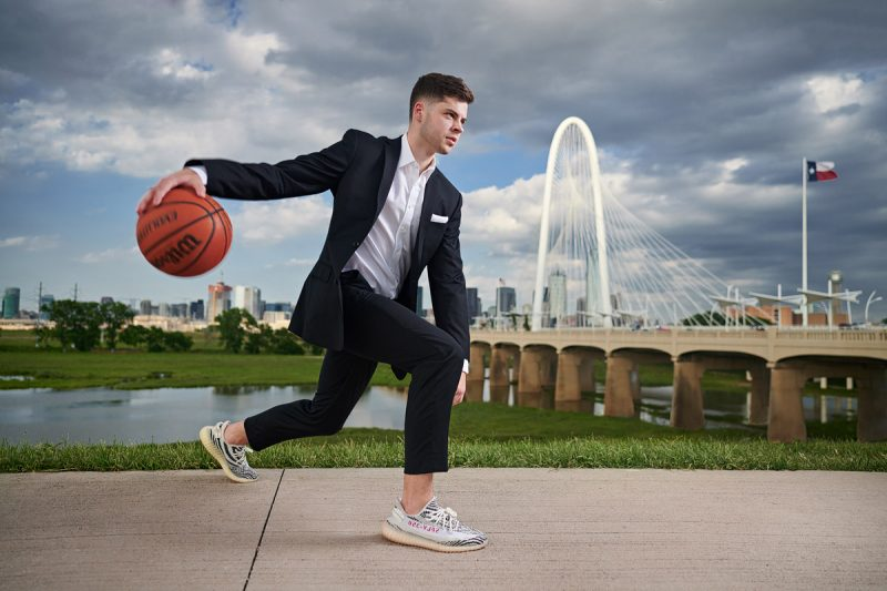 Bishop Lynch Senior Portraits with Jake in downtown Dallas senior photos on Kirk Bridge
